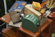 Sale 8287 - Lot 1012 - Roama Film Strip Projector with Two Boxes of Film Reels incl. Disney & Early Australian Stills