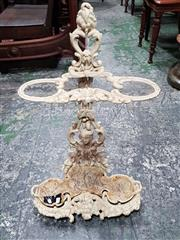 Sale 8714 - Lot 1019 - Probably Victorian Cast Iron Stick Stand, painted white, with floral decor & mask head, number to back