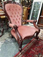 Sale 8925 - Lot 1038 - A victorian grandmother chair in salmon pink buttonback upholstery on porcelain castors