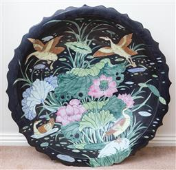 Sale 9103M - Lot 704 - A large and decorative Japanese charger depicting ducks and lotus on a black ground with shaped edge and marks to base. Diameter 63cm