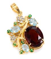 Sale 8899 - Lot 330 - A 9CT GOLD DIAMOND AND GEMSTONE PENDANT; set with a large oval cut citrine (approx. 15.8ct), aquamarines and blue topaz, round cut g...