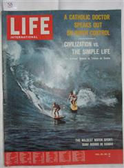 Sale 8431B - Lot 58 - Front cover and article, Riding in Wild Oahu Waves. 12 pages of Life International Magazine, June 3, 1963