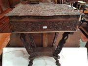 Sale 8917 - Lot 1099 - Javanese Carved Sewing Table, with carved foliate design and dragons, the hinged top revealing a fitted interior & on shaped support...