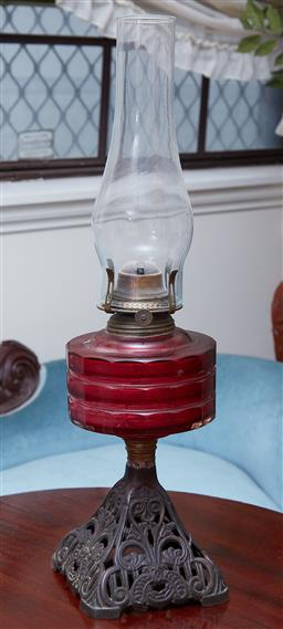 Sale 9103M - Lot 482 - A ruby red mid section kerosene lantern with flute, Height 51cm