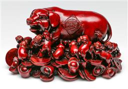 Sale 9209V - Lot 38 - Resin Chinese pig on bed of coins (W: 20cm)
