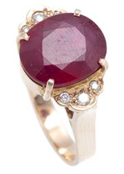 Sale 8937 - Lot 453 - A RUBY AND DIAMOND RING; set in 9ct gold with an oval cut glass treated ruby between 6 round brilliant cut shoulder diamonds, size N...