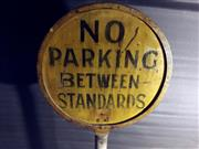 Sale 8579 - Lot 72 - A vintage painted steel No Parking Between Standards sign approved by police department on heavy cast base with some wear commensura...