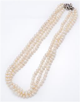 Sale 9120H - Lot 289 - A three strand cultured pearl necklace, 7mm cultured fresh water pearls with a sapphire and diamond set clasp in 18ct white gold bow...