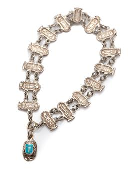Sale 9177 - Lot 314 - A SILVER ANCIENT EGYPTIAN THEMED BRACELET WITH CHARM; composed of hieroglyphic plaques to a blue enamelled scarab motif clasp, lengt...