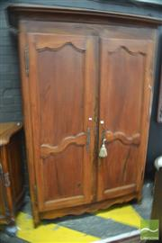 Sale 8291 - Lot 1076 - Antique Style Mixed Fruitwood Armoire, with two shaped panel doors (key in office)
