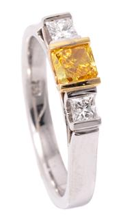 Sale 8980J - Lot 50 - An 18ct White Gold Yellow and White Diamond Ring; featuring a fancy yellow radiant cut diamond of 0.37ct with GIA cert. between the...