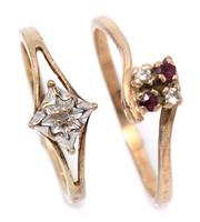 Sale 9066 - Lot 304 - TWO 9CT GOLD STONE SET RINGS; one illusion starburst set with a single cut diamond, size J, other set with 2 round brilliant cut dia...
