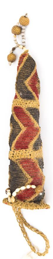 Sale 8269A - Lot 73 - A New Guinea woven penis sheath, with geometric ridges and hollows with seven tassels of jobstear seedpods and small pine cones, L 28cm