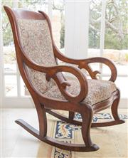 Sale 8470H - Lot 386 - A late C19th cedar rocking chair with scrolled arms and upholstered in floral fabric, split to one arm