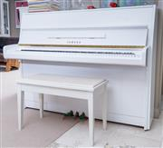 Sale 8593A - Lot 64 - A Yamaha white upright piano, of good tone, in good condition, W 150cm, together with a stool, and music