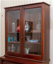 Sale 9058H - Lot 85 - A Victorian bevelled glass two door display cabinet with shelved interior. H-120  W-104 D-34cm