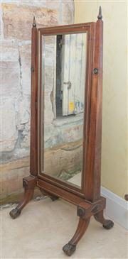 Sale 8470H - Lot 389 - A Regency style mahogany cheval mirror, with brass mouldings and tapering supports raised on out swept legs, with paw feet