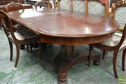 Sale 8500 - Lot 1032 - Early 19th Century Mahogany Extension Dining Table, with four leaves, on a turned split pedestal, quadraform base with concealed cas...