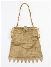Sale 8541A - Lot 51 - An antique gilt mesh purse with beautiful decorative design and white stones on clasp