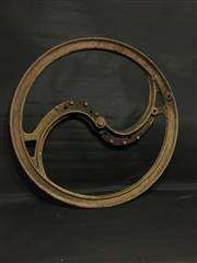 Sale 8579 - Lot 75 - An industrial cast iron wheel with wear commensurate with age, diameter 84 cm