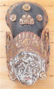 Sale 8550H - Lot 168 - An antique Balinese timber mask of a woman with a head dress painted with white, red, black and gold, H 53cm