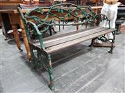 Sale 8714 - Lot 1002 - Australian Cast Iron Furphy Garden Bench, of intertwined oak branches, & timber slats, name to back, closely modelled on a Coalbrook...