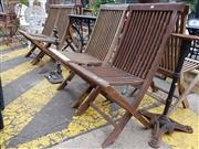 Sale 8740 - Lot 1235 - Set of 6 Teak Folding Outdoor Chairs
