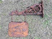 Sale 8579 - Lot 76 - An antique cast iron shop sign and bracket with surface rust, L 70cm