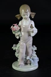Sale 8994 - Lot 14 - Lladro figure of a spring girl (H18.5cm, loss to a petal)