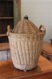 Sale 7379B - Lot 59 - Vintage two handled wicker basket containing a bottle. Height 62cm