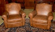 Sale 8015A - Lot 23 - A pair of French style club chairs in leather