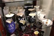 Sale 8014 - Lot 69 - Black & White  Whisky Jugs, Esky and Ashtrays, incl. Beefeater Gin and Vat 69 Jugs.