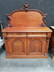 Sale 8666 - Lot 1069 - Victorian Mahogany Chiffonier, with carved back, two drawers & two arched panel doors