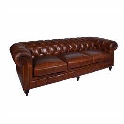 Sale 9245T - Lot 52 - A four seat traditional style Chesterfield sofa in premium, natural hand aged leather, with a brass stud trim, buttons and darkened...