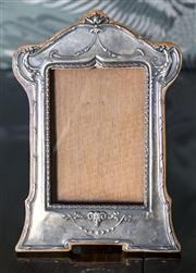 Sale 8222 - Lot 79 - A silver photo frame, P&C , Birmingham, England, with rams head decoration