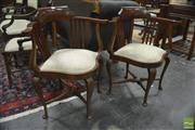 Sale 8345 - Lot 1004 - Pair of Edwardian Maple Corner Chairs, with slatted backs, cream upholstery & cabriole legs joined by stretchers