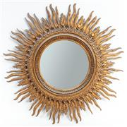 Sale 8960J - Lot 23 - Large starburst mirror, the carved timber frame with a gilt painted finish and some white speckled paint detail, diameter 120cm