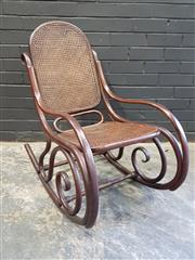 Sale 8993 - Lot 1098 - Beech Bentwood Rocking Armchair, with caned back & seat