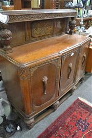 Sale 8093 - Lot 1544 - 1930s Carved Oak Sideboard, with low back and three panel doors
