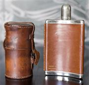 Sale 8222 - Lot 38 - A 12oz EP hip flask with leather case, together with partial portable drink set with leather case and two glass bottles Film Prove...