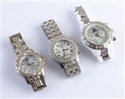 Sale 8550F - Lot 172 - Three stainless steel diamante fashion wristwatches.