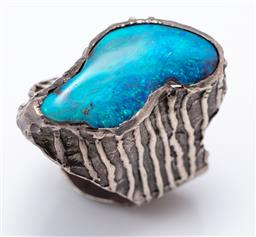 Sale 9120H - Lot 297 - A Sterling silver and boulder opal ring of organic form. size V