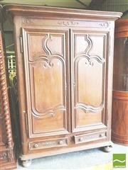 Sale 8409 - Lot 1701 - 18th Century French Oak Armoire, with two shaped panel doors, above two drawers