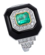 Sale 9029 - Lot 369 - A DECO STYLE 18CT WHITE GOLD EMERALD DIAMOND AND ONYX RING; centring an emerald cut emerald of approx. 1.23ct within a surround of 1...