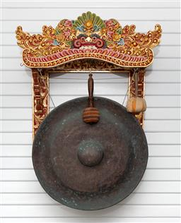 Sale 9164H - Lot 2 - A large antique bronze gong with modern Balinese wall mount support together with two padded mallets.