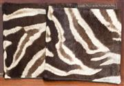 Sale 8261A - Lot 43 - Two zebra hide cushions, 45 x 45cm