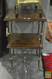 Sale 8359 - Lot 1096 - A Victorian Walnut Whatnot with turned brass supports joined by a stretcher.