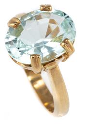Sale 8899 - Lot 338 - A SOLITAIRE AQUAMARINE 9CT GOLD RING; split claw set with an oval aquamarine estimated as 4.53ct, size N, wt. 5.5g, minor chip on gi...