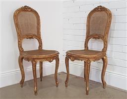 Sale 9179 - Lot 1031 - Pair of French Eclectic Style Gilt Side Chairs, with scroll carved & caned backs and seats, raised cabriole legs (h:102 w:47 d:44cm)