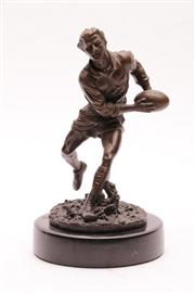 Sale 9023 - Lot 3 - Cast Metal Figure of a Rugby Player With a Bronze Coloured Finish H: 22cm